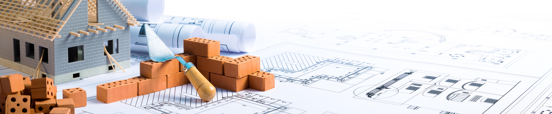 Haus auf Bauplänen